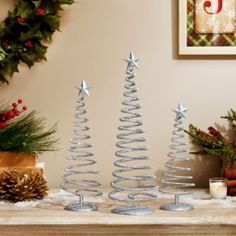 Decorate your home with the spiraling shine of the Sparkly Silver Swirl Trees. #kirklands #holidaydecor #KirklandsHoliday