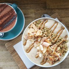 """everydaysimplehealth: """" Vegan hot (70% dark) chocolate + a banana and date smoothie bowl topped with a thick date sauce, caramelised buckinis & some delicious toasted coconut chips. If I could have this amazing meal delivered to my bed from..."""