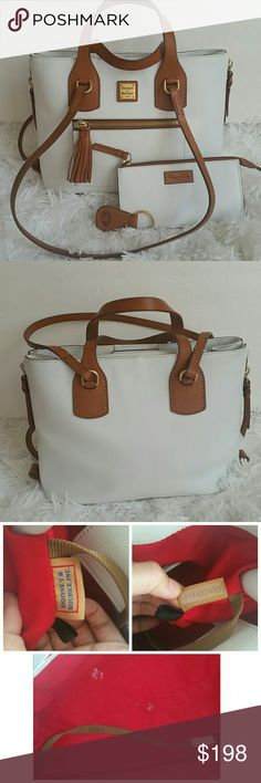 """Dooney & Bourke Leather Shopper with Accessories Preown. In great condition. Has some wear on the bottom corners. But isn't noticeable. Inside have 2 small white mark. Pictures  shows above. Other than that. Comes with all accessories. Beautiful bag. Approximate measurements: Bag 12-1/2""""W x 9-1/2""""H x 5""""D with a 4-1/2"""" handle drop and a 13-1/2"""" strap drop, weighs approximately 2 lbs, 5 oz; Pouch 7-1/2""""W x 4""""H x 1/8""""D, accommodates all iPhone sizes Body/trim 100% cowhide leather; lining 100%…"""