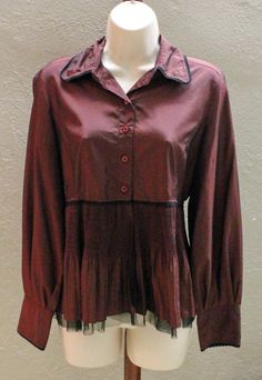 This blouse is great with both fancier skirts and simple jeans.