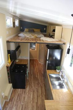"""This tiny house offers some of the largest lofts I've seen -- a California king master loft and a queen """"storage"""" loft -- totaling over 110-square-feet."""