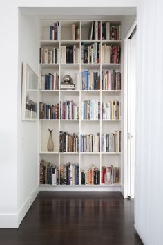 """When I found this pin it said, """"End a hallway prematurely with an installed bookshelf and then add molding along the floor to make it look built in."""""""