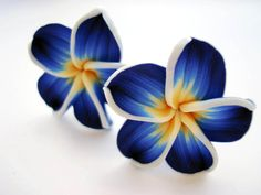 Blue Hawaii flower -CLIP ON- earrings  (extravagant kitchy fimo clay flower). €12,80, via Etsy.