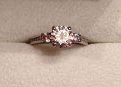Moissanite vs. diamond. Everyone should read this. @cade06a . LOOOOOK. READ the info, not this ring though (ew)