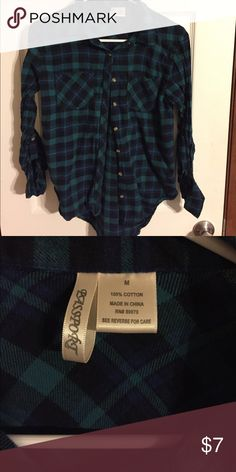 Green & Black Plaid Green & Black Hi-Low Plaid shirt. Has tabs for rolling up the sleeves. Size Medium. Pet Free, Smoke Free Home Passport Tops Button Down Shirts