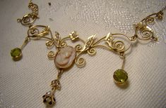 Edwardian Pink Coral Cameo Peridot and Seed Pearls Lavaliere Necklace 1900 1910 Antique Jewelry, Bride Necklace, Cameo Jewelry, Jewellery, Green Peridot, Just In Case, Amethyst, Coral, Schmuck