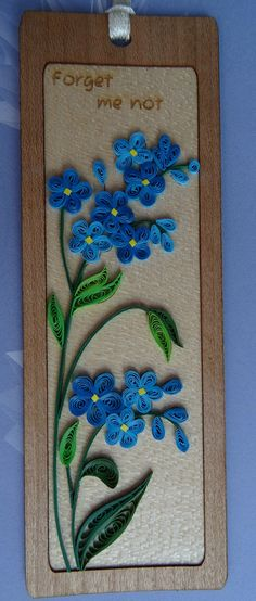 Bespoke handmade quilling bookmark. blue forget me not flower, quilling paper, wood background, quilling art and craft by Hiquilling on Etsy https://www.etsy.com/listing/211007046/bespoke-handmade-quilling-bookmark-blue