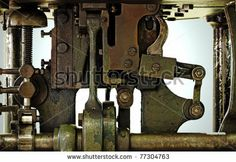 Closeup of an antique copper mechanical engine parts on a metal stamping machine. by Gwoeii, via Shutterstock