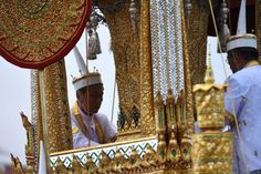 Thai royal doctors travel with the Royal Urn during the funeral procession for the late Thai king Bhumibol Adulyadej in Bangkok on October 26 2017 A...