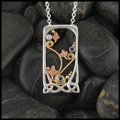 Sweet and dainty Mother's pendant with spirals and ivy.
