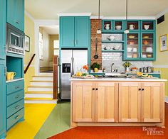 Bright, dramatic colors can be difficult to embrace, which is why homeowners often gravitate toward one hue. But if your aesthetic is a bit more eclectic, you can blend a few options, particularly if they're in the same shade family -- here, hues that are more neon than they are calming. The key to making this work is the rest of the space: There are no fussy details on cabinets, no excessive wall treatments. Instead, the color mix of turquoise, yellow, orange, and green works its magic…