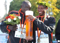 Winner Geoffrey Mutai (right) and runner-up Dennis Kimetto of Kenya drink a beer after the 39th Berlin Marathon