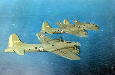 Three B-17E Flying Fortress bombers in flight probably flying from Hendricks Filed Florida United States 1941-1942