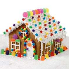 Gumdrop Cottage Gingerbread House - Multi-colored candies and creative icing decorations make this cottage a project that everyone can't wait to finish. Colorful window trims and walkways lined with candies are such great looks to create for the whole family.