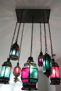 Indie Fashion and Beauty: DIY Moroccan Lantern Chandelier - Love this person's chandelier made from various Moroccan lanterns.  The ceiling plate is a spray-painted radiator cover panel from Home Depot!  So smart!