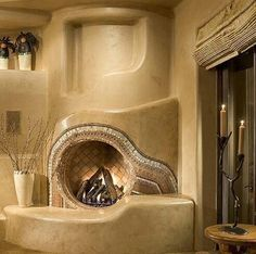 High thermal mass clay sculpted fireplace