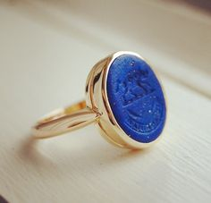 """Lapis lazuli seal ring that reads in Latin, """"Nil admirari,"""" which means """"be surprised at nothing."""""""
