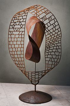 This is another of sculptor Kevin Caron's kinetic sculptures. See the movie of this one - which was stolen and has not yet been recovered - spinning at http://www.kevincaron.com/art_detail/mobilus.html
