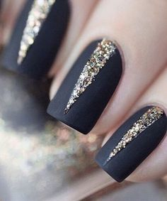 This matte black and sparkly New Year's nails are just perfect.