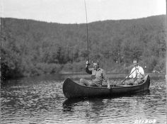 Fishing from canoe with barbless hook.    Caption: Fishing from canoe with barb-less hook. Mr. Dinsmore and W. D. Black. White Mountain National Forest, New Hampshire.    Date: August, 1926