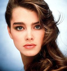 1980s - 90s How to Get Brooke Shields' + Cindy Crawford's Strong Brows - (Part B of Tutorial) 2. You only want to fill in the sparse areas of your brows; otherwise, they'll look drawn on. Start by sketching the pencil along — but not above — the top edge of each brow using short, light flicks. Next, fill in just the bald spots, again with short flicks — and then, stop. 3. Sweep a spooled brush through your brows to blend in the pencil and create a soft, flawless finish. (From Redbook…