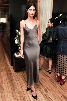 Lily Aldridge is every bit stunning in this party-ready silk slip dress look. The model kept the outfit sleek, yet simple by pairing her gunmetal grey dress with a mini pendant necklace and strappy black pumps.