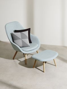 Light blue midcentury chair and matching footstool \\ COS × HAY