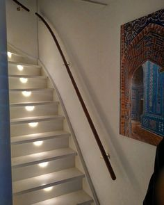 Automatic stairlights with PIR sensor:  A PIR sensor triggers a 24V powersupply which feeds a string of potential distributors behind each stair. The LED strips are in a plastic U profile and plugged in through the back of the stairs.