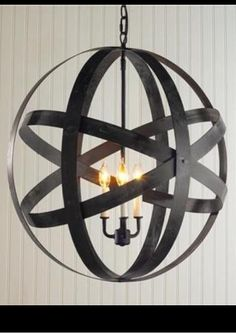 Soon to be light fixture DIY metal rings welded together light fixture drilled in middle....