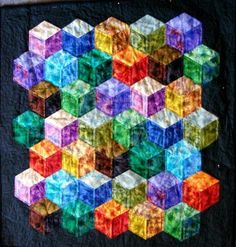 Tumbling Blocks - this makes me think that this pattern would be nice in Batik fabric.