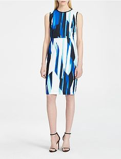 a sleek sleeveless dress featuring fine crepe fabric, an abstract stripe design, a high neckline and a back zip closure.