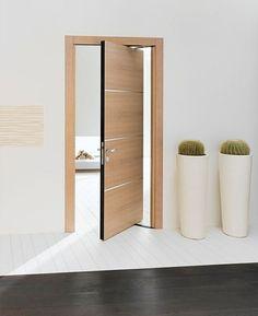 une porte pivotante en bois avec un design contemporain