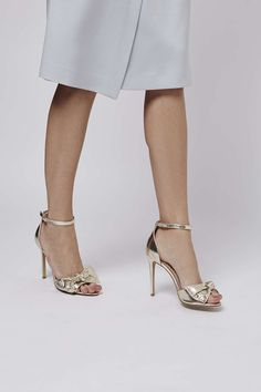 Metallic bow heels with ankle strap detailing are the only shoes you'll need for party season. #Topshop