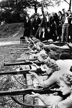 Members of the Watford Womens Home Defense Unit practice their aim on the rifle range, as other members wait their turn to shoot in 1942 (left). This unit was composed mainly of business and professional women who took the rifle instruction during their leisure time.