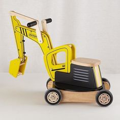 The Land of Nod Excavator Ride-On: Construction-loving kiddos are guaranteed hours of fun on this wooden excavator ($119). It features a 360-degree swiveling seat and a backhoe for heavy-duty sandbox or sidewalk projects.
