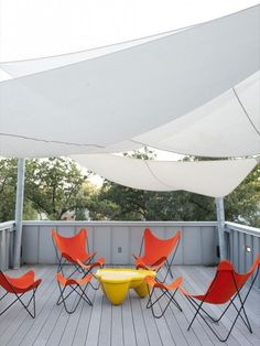 These sail boat sun shades are dreamy for an outdoor space, especially on the roof deck of a super modern home.
