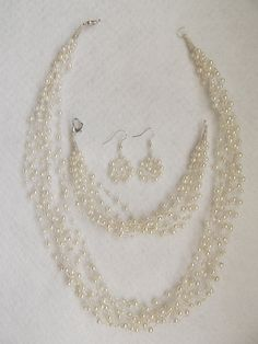 Silver plated wire crochet jewelry with white glass pearls, bridal jewelry. £29.00, via Etsy.