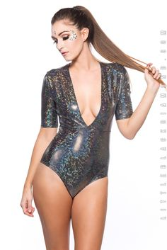 **Get these while you can, they won't be restocked !** Just like pokemon cards... holographic is always better! We love our Jet Set Bodysuit in the snowy white hologram and galactic black hologram. The Jet Set Bodysuit features a plunging neckline and sleeves with a bootylicious cut in the back.