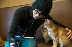 Even kitties seriously pose with him <3