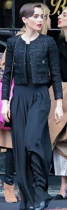 Who made Lily Collins' black tweed jacket and quilted handbag? (OutfitID)