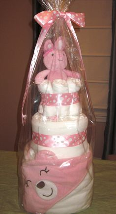 Cloth Diaper Cake - pink. Includes: 1 bath towel, 2 receiving blankets, 15 onesies, 6 cloth diapers, 6 washcloths, and 1 pink bunny.