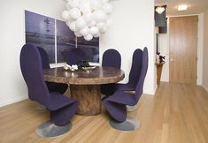 this is wild..purple chairs ..love the rustic table