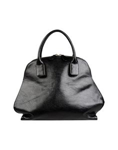 Yohji Yamamoto : Style - Minimal + Classic Not a holistic medicine bag, but seems very nice for carrying my essential oils case!