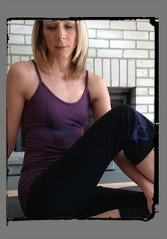 The #SqueezedYogaClothing #FlyingHeart on our EggplantBamboo Bra Cami and Black Capris http://squeezed.ca/shop/black-yoga-capri-with-violet-flying-heart
