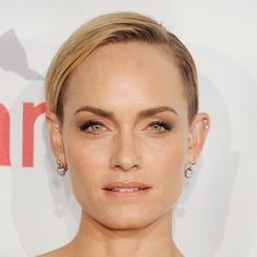 Younger: A closely shorn pixie worn slicked down and parted on the side is infinitely more lively (and flattering).