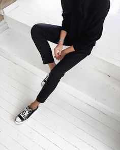 pants, a sweater and black Converse for a casual chic look