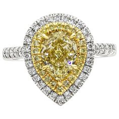 For Sale on 1stDibs - A brilliant engagement ring style showcasing a color-rich pear shape yellow diamond weighing 2.01 carats, certified by GIA as Fancy Light Yellow color, Engagement Ring Prices, Double Halo Engagement Ring, Pear Shaped Engagement Rings, Engagement Ring Shapes, Pear Shaped Diamond, Diamond Cuts, Cushion Cut Diamonds, Fashion Rings, Fancy
