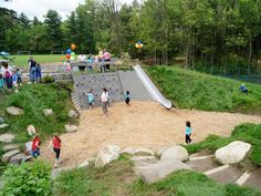 naturalplaygrounds.com not exactly right, but i like the slide, climbing wall, and construction (sand) area in a hill.