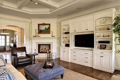 Corner fireplace with built in bookshelves family room traditional with tv built in tv built in inlay carpet