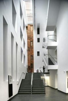 New meets old - in the foyer From the Place North West Example Of News, University Architecture, Gothic Buildings, Library Inspiration, Manchester, Facade, The Good Place, Stairs, Amazing Places